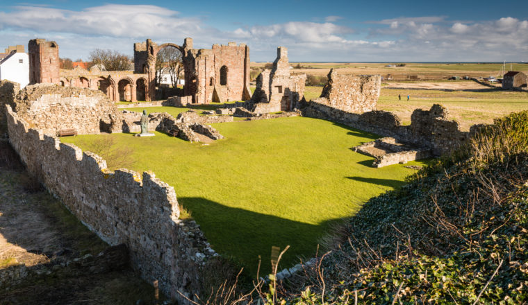 Ruins of Lindisfarne Priory on Holy Island on a sunny day